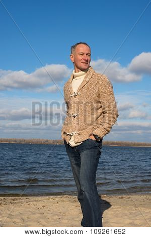 Attractive Happy Man, Wearing Casually, Walking Along The Coast In Magic Autumn Day
