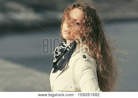 Beautiful fashion woman with long curly hairs outdoor