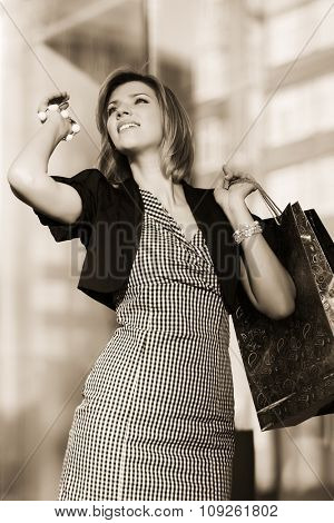 Happy young fashion woman with shopping bags at the mall