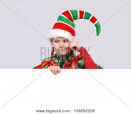 Girl in suit of Christmas elf with the banner