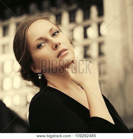 Sad beautiful fashion woman in black dress