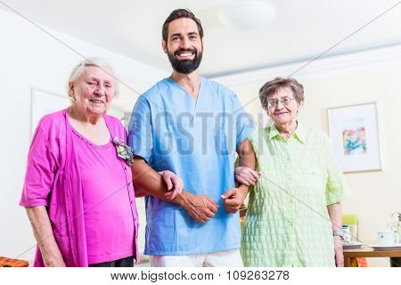 Caregiver with senior women in nursing home