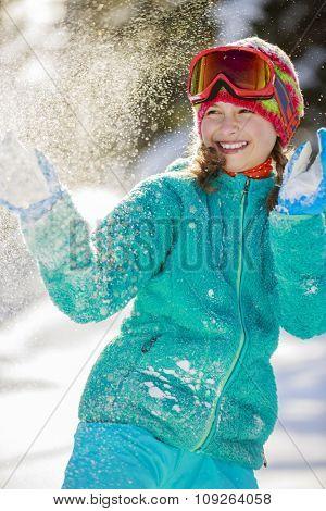 Ski, beautiful and young skier girl enjoying winter vacation