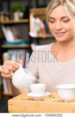 Tea drinking among books