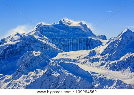 Panorama of snow mountain range.Landscape at Mt Fort Peak Alps region Switzerland