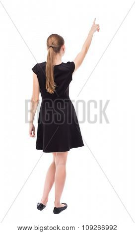 Back view of  woman thumbs up. Rear view people collection. backside view of person. Isolated over white background. The blonde in a black dress shows a finger up his right hand.