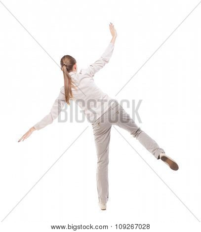 Balancing young woman.  or dodge falling woman. Rear view people collection.  .  Isolated over white background. Girl with long hair in a white jacket falls on the side, razmahvaya hands.