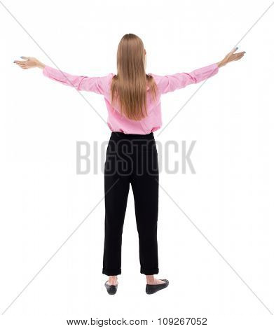 Back view of  business woman.  Raised his fist up in victory sign.  Rear view people collection.  Isolated over white background. The girl office worker in black pants raised his hands to the sky.