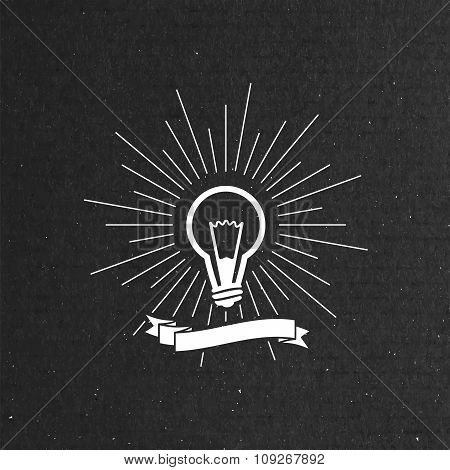 light bulb label with ribbon and light rays