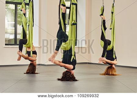 Antigravity yoga exercise. group