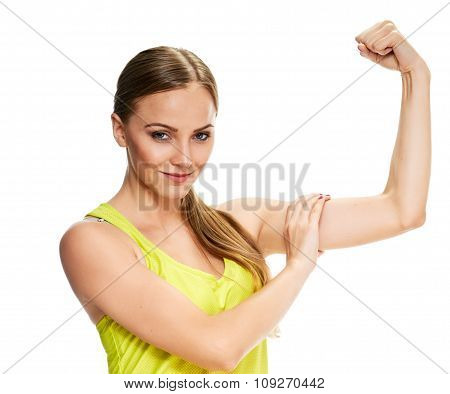 woman fitness portrait. showing her biceps