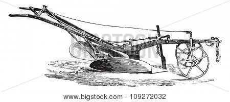 Ransomes plow turns ear, vintage engraved illustration. Industrial encyclopedia E.-O. Lami - 1875.