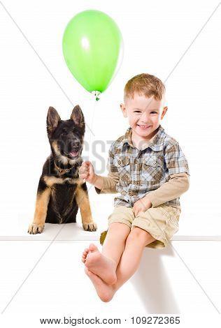 Happy boy and puppy German Shepherd