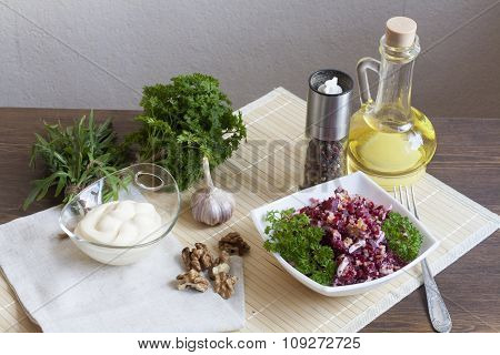 Beetroot salad with walnuts and cream sauce. Nuts, garlic, salt, pepper, herbs, boiled eggs and oil
