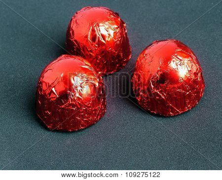 Three small sweets isolated. Red cookies