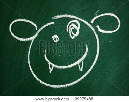 Funny smiley on school blackboard. Devil smile