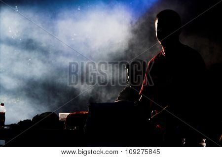 Two DJ Performing On Stage. DJ duo playing music on the concert