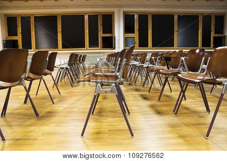 Empty classroom. Rows of student chairs in empty university classroom