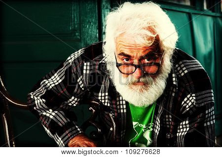 Old man portrait. Old man with grey beard color manipulated
