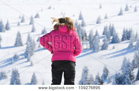 Girl and snow mountain landscape. Winter holiday and ski concept
