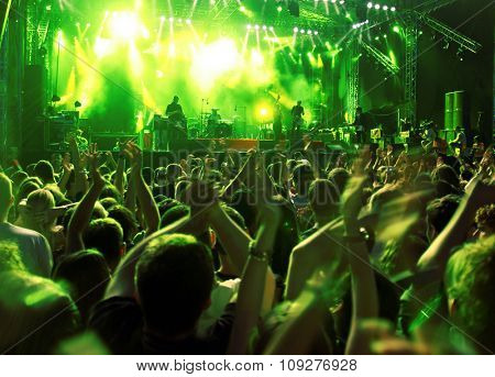 Band at a rock concert. Blur crowd
