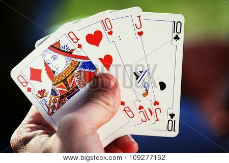 Casino concept with cards. Hand holding poker cards