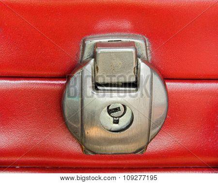 Locked  red suitcase detail