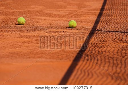 Detail of clay tennis court with Tennis ball and net. Useful for tennis background designs