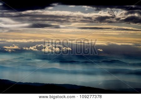 Dramatic sky with many layers. Photo taken from a high mountain