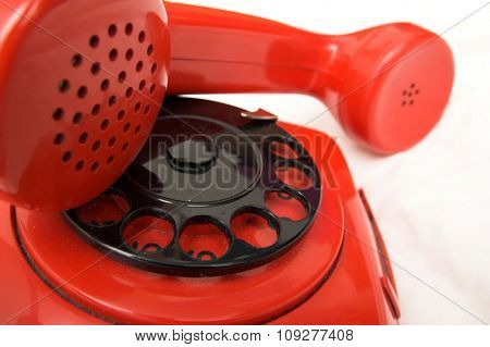 Dusty old retro red phone. Retro industrial design
