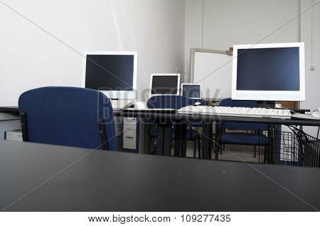 Computer classroom. Computers in row in school classroom