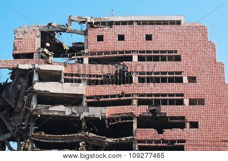 Bombed and abandoned city building. Architecture ruins and destruction