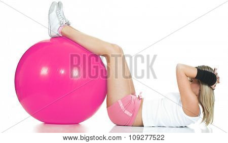 Pilates trainer doing stomach exercise. Pilates ball and fitness girl concept