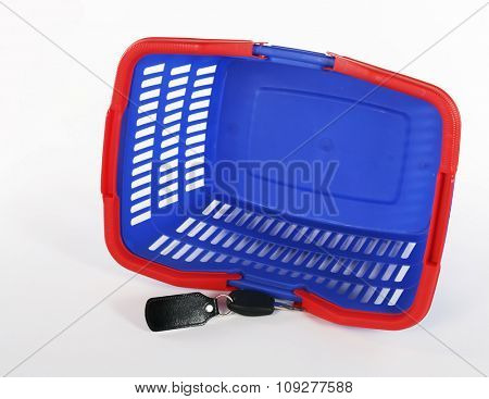 Isolated shopping bag and car keys. Car shopping concept