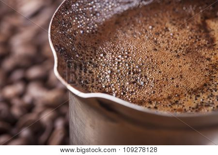 Coffee beans background, vintage copper coffee pot closeup