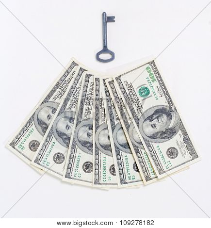 Money unlock concept. US dollars and a key to success