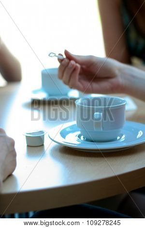 Woman hand and cup of coffee. Coffee break meeting concept