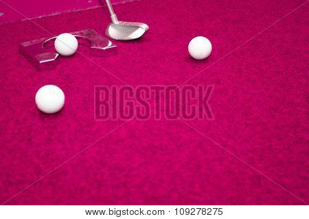 Modern businessman or manager playing golf in office concept.Golfing balls