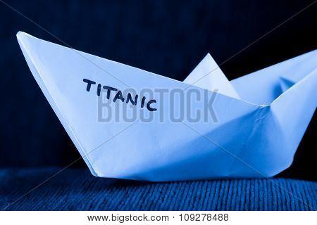 origami paper ship model in blue - titanic concept