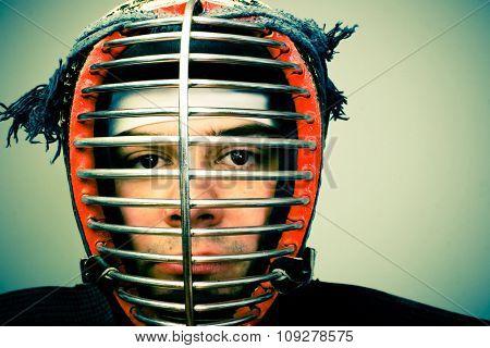 martial arts concept portrait Man in kendo helmet