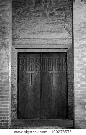 Cross on spooky church door. Worship concept