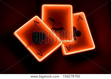 Casino sign - label. Three playing cards - aces and joker
