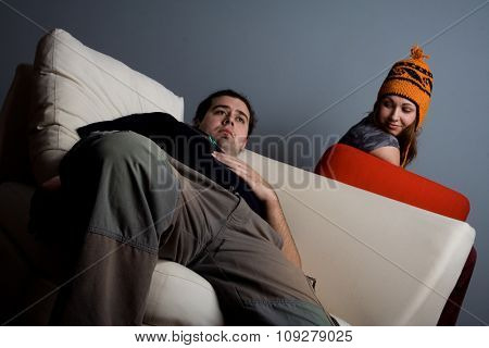 Woman and man sitting on sofa bored. Lounge concept