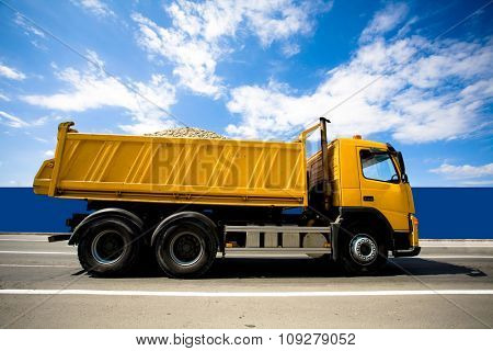 Big heavy truck on the road loaded