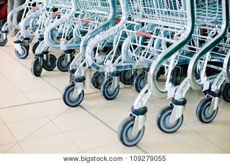 Shopping carts in supermarket ready for consumers. Buy and sell concept