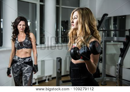 Two Women In The Gym Training.