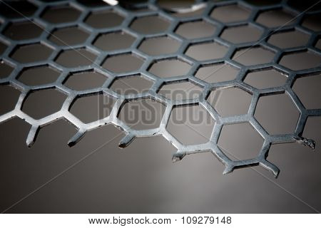 Abstract Background of metal hex grid pattern and part missing