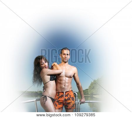 Couple in hug on boat enjoying a sunny summer day. Clear blue sky and vivid colors