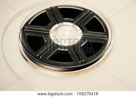 Retro Film reel on a brown background. Movie industry concept