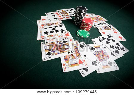 Chips and cards on green poker table. Casino and gambling concept